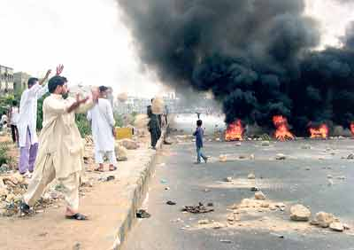 An angry crowd protests power cuts in Multan, Pakistan