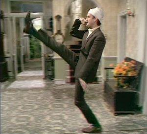 Basil Fawlty trying not to mention the war
